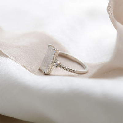 Gold baguette moonstone ring with side diamonds TIGE