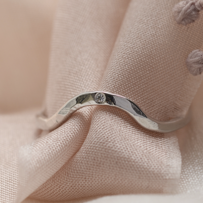 Hammered curvy wedding ring with diamond ASHLING