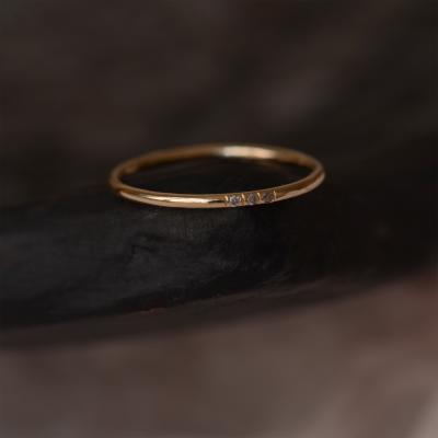 Gold minimalist ring with salt and pepper diamonds OLU