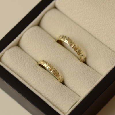Gold wedding rings with a relief surface FIO
